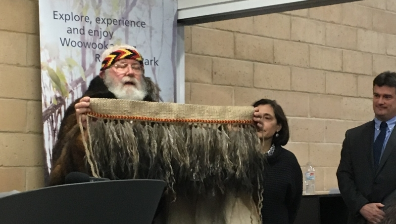 Uncle Bryan and Aunty Vi present the minister with a hand crafted enu feather skirt, at the opening of Woorookarung Regional Park