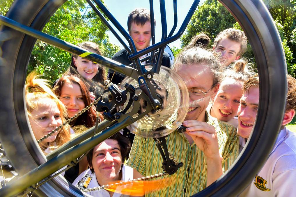 Members of the Daylesford Repair Cafe take a look at bike gears Photo Brendan McCarthy